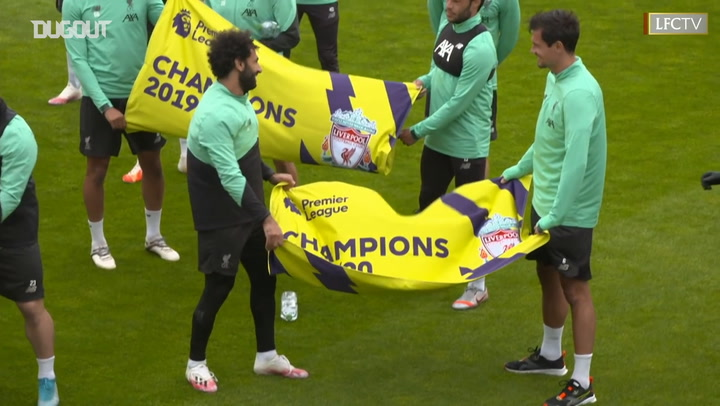Liverpool presented with Premier League champions flags at training ground