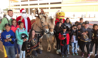 Golden Knights Santa Surprises Kids with Gifts