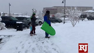 People enjoying the snow in Summerlin