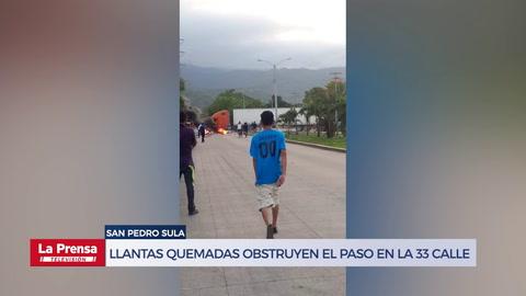 Llantas quemadas obstruyen el paso vehícular en la 33 calle de San Pedro Sula