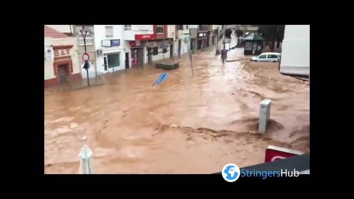 Spain floods: Streams of water flow down streets in Almendralejo