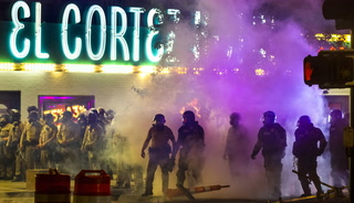 Metro Police use tear gas on protesters downtown.