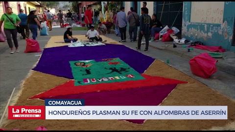 Hondureños plasman su fe con alfombras de aserrín
