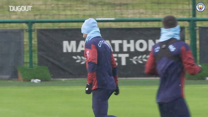 Sergio Aguero takes part in snowy Manchester City training