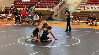 Staples-Motley's Dalton Wells pins for a 132-pound match win