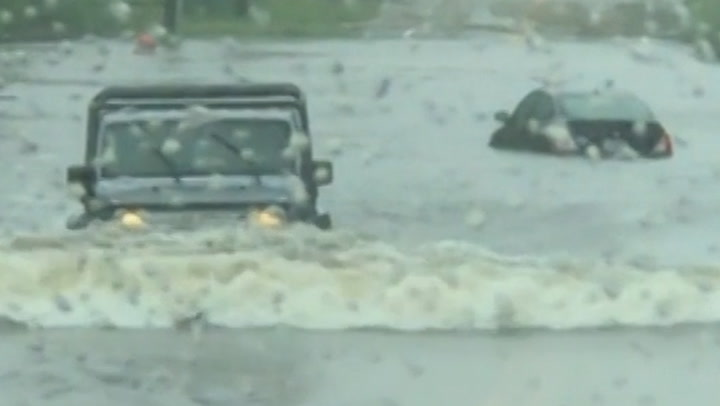 Drivers struggle through floodwaters