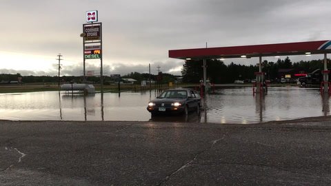 """Friday's rainfall turned the parking lot of the Corner Store in Backus into one of Minnesota's smaller lakes. The Weather Channel's 24-hour precipitation estimate indicated almost 4"""" of rain had fallen in the Backus area."""