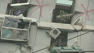 Search continues for survivors in a toppled building in Taiwan
