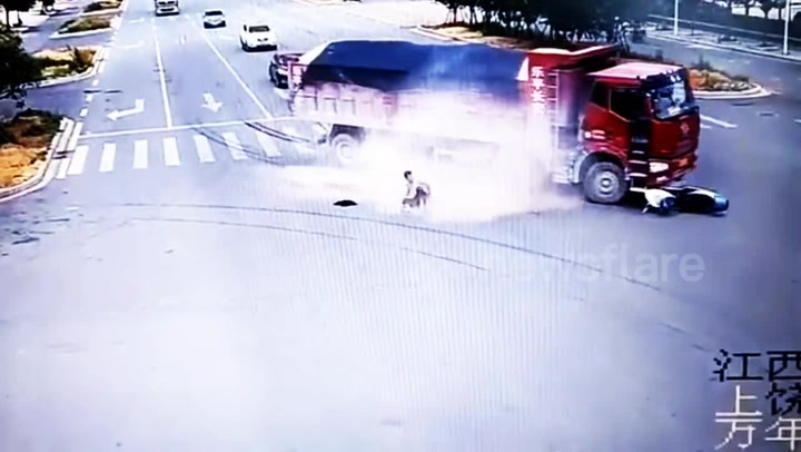 Motorbiker Miraculously Survives Two Trucks Nearly Running Him Over Back-To-Back