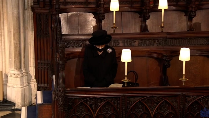 The Queen looks on during the funeral of Prince Philip