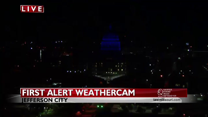 State Capitol dome lit up in blue to honor fallen officers