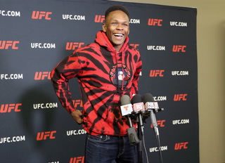 Israel Adesanya says McGregor and Rousey's rise helped him with UFC fame