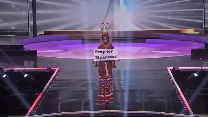 Miss Universe Myanmar contestant holds 'Pray for Myanmar' sign