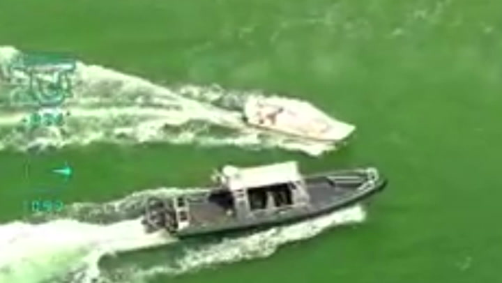 Police chase out-of-control boat circling close to Florida beach