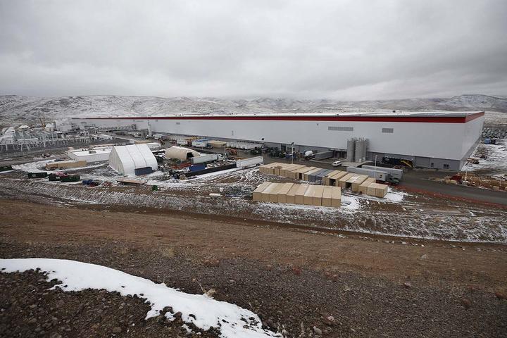 Tesla Vice President Chris Lister leads a tour of the facility. (Bill Dentzer/Las Vegas Review-Journal)