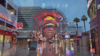 Wet and cold weather (for some) in downtown Las Vegas – VIDEO