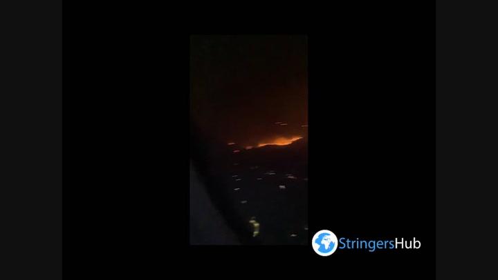 Wildfire rages through Rhodes forest as plane passenger films destruction
