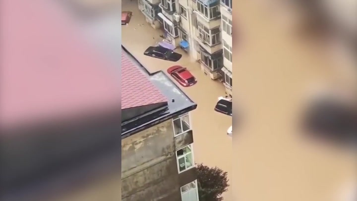 Floods sweep away cars with people trapped inside in China