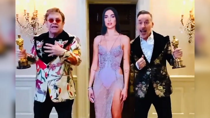 Elton John films at £5million luxury home before legendary Oscars party