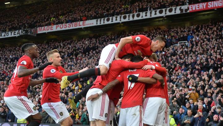Los jugadores del United celebran su victoria ante el City