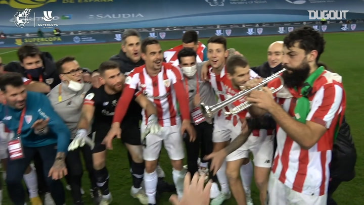 Goalscorer Asier Villalibre plays the trumpet during Athletic's celebrations