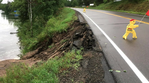 A large portion of the shoulder of State Highway 87 near the Salty Dog Restaurant on Sanborn Lake, about 2 miles northeast of Backus, washed out and slid down into the lake during Friday's massive rainstorm.