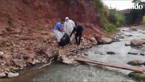Exhuman cadáver de mujer asesinada en una quebrada en Tegucigalpa