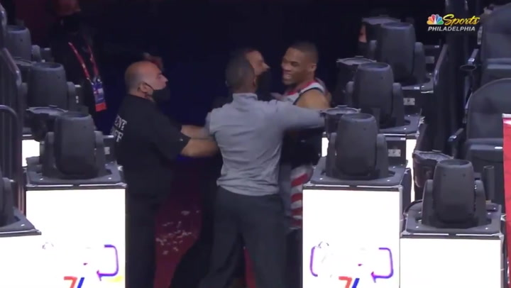 Fan throws popcorn at NBA star Russell Westbrook as he leaves court