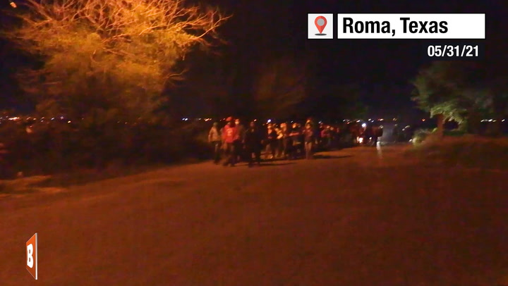 Large Group of Migrants March Through South Texas Neighborhood at Night
