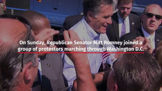 Mitt Romney marches in Washington, D.C., protest – Video