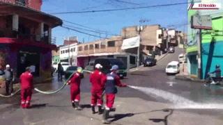 Desinfectan calle frente al mercado Mama Chepa de Comayagüela
