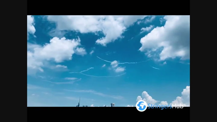 Japanese fighter pilots draw Olympic rings in Tokyo sky ahead of opening ceremony