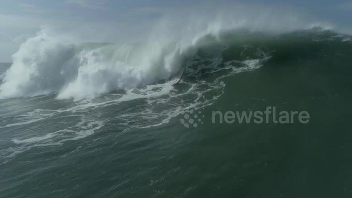 Surfer Tries To Catch Wave At Nazaré, Promptly Gets Destroyed By Two Massive Waves