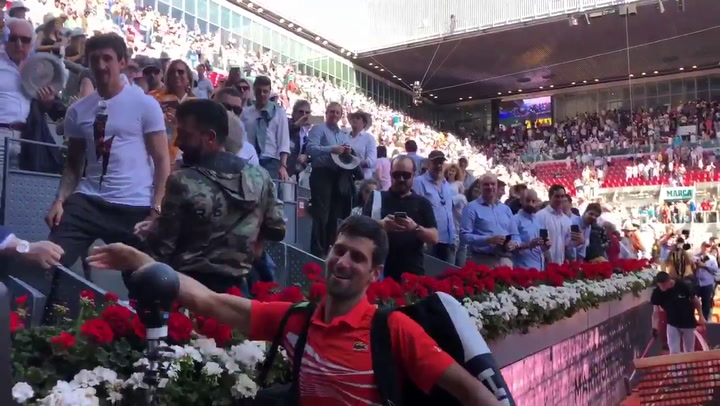 Djokovic celebra su pase a la final del Mútua Madrid Open