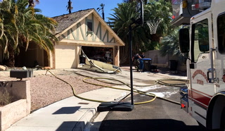 Backyard house fire spreads to 2nd structure in Henderson