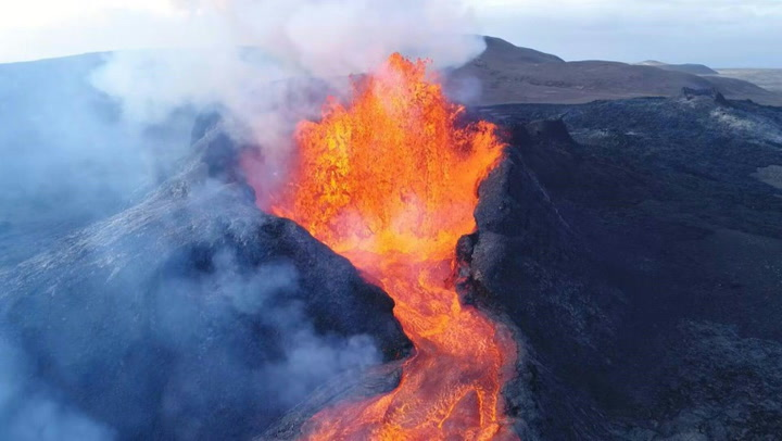 Iceland's Fagradalsfjall volcano erupts sending crater rim collapsing into lava pond