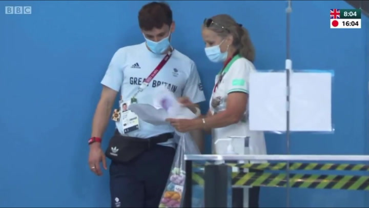 Tom Daley takes delivery of fresh yarn while watching Olympic diving