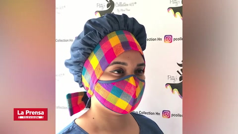 Hondureña causa furor con mascarillas y vestidos artesanales