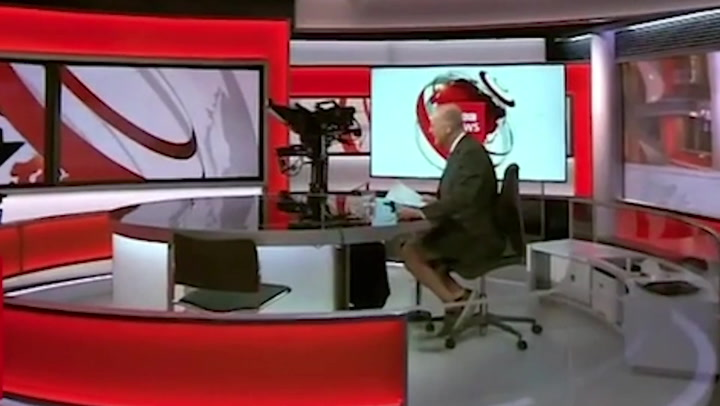 BBC anchor caught wearing shorts under desk as he presents news live