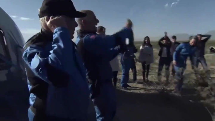 Jeff Bezos interrupts emotional William Shatner to spray champagne after rocket landing