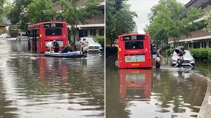 London weather: Passengers rescued from stranded bus by hero residents on inflatable boat