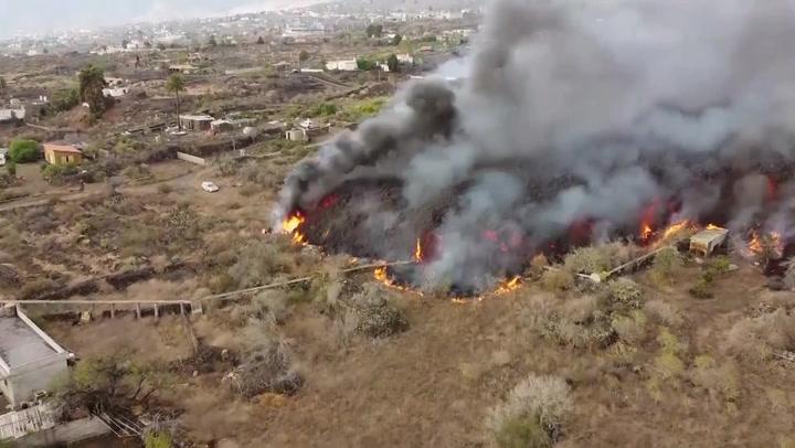 Drone footage shows lava flowing from La Palma volcano towards ocean
