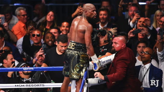 Covering the Cage: Mayweather Wins by TKO