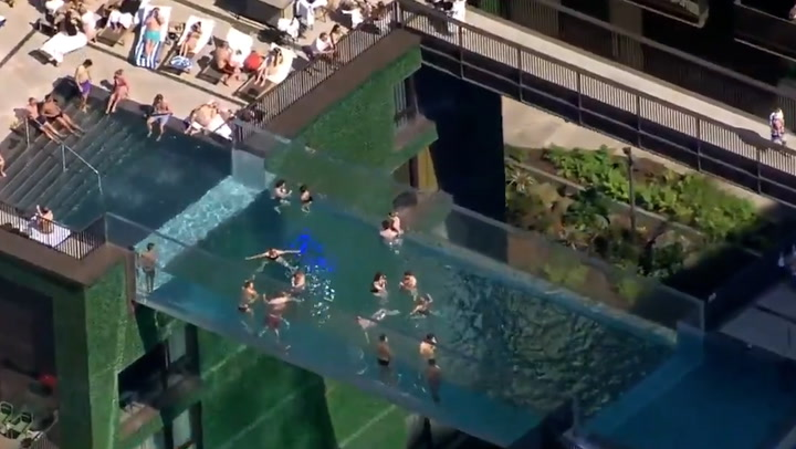 Swimmers enjoy world's first transparent 'sky pool' 35 metres above ground in London