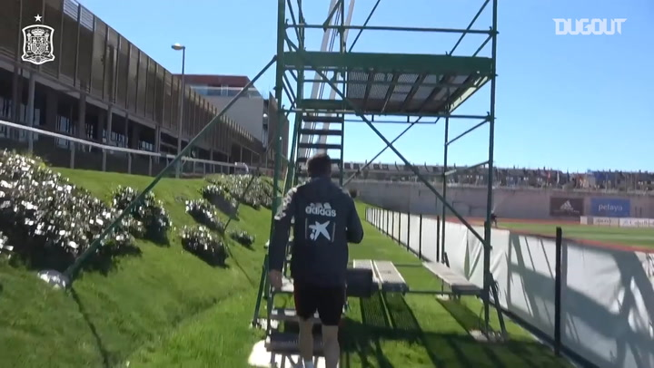 Luis Enrique coaches Spain players from a scaffolding platform