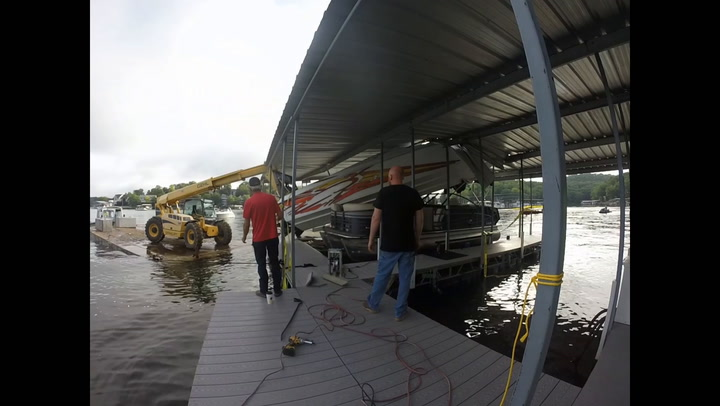 Crews remove boat from dock at Lake of the Ozarks