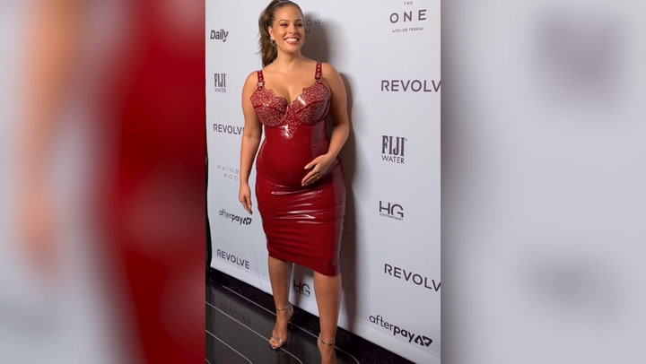 Pregnant Ashley Graham Shows Baby Bump in Leather Dress