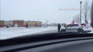 40-50 vehicles escort Officer Moszer to Grand Forks, returning to Fargo around noon
