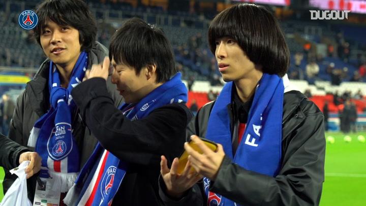 Japan's Paris Saint-Germain Fan club attend the match against Monaco