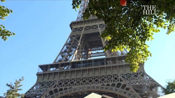 Eiffel Tower evacuated, closed after intruder attempts to scale it